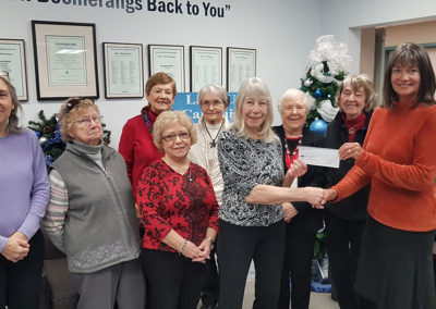 The Castlegar Hospital Auxiliary President Wendy Schwab presents the Auxiliary's generous donation to Stefanie Zaytsoff of the Castlegar Hospital Foundation.